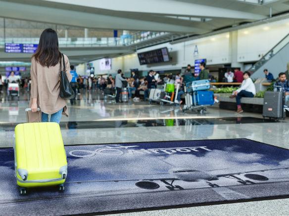 Logomåtte i lufthavn
